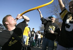 University of Iowa fans party at a Hawkeye football tailgate.