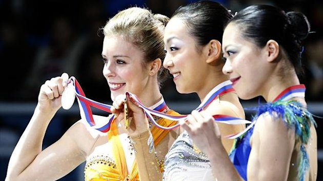 Gold medallist Mao Asada (C) of Japan poses with silver medallist Ashley Wagner (L) of the U.S. and bronze medallist Akiko Suzuki of Japan during the award ceremony for the women's competition at the Grand Prix of Figure Skating Final in Sochi (Reuters)