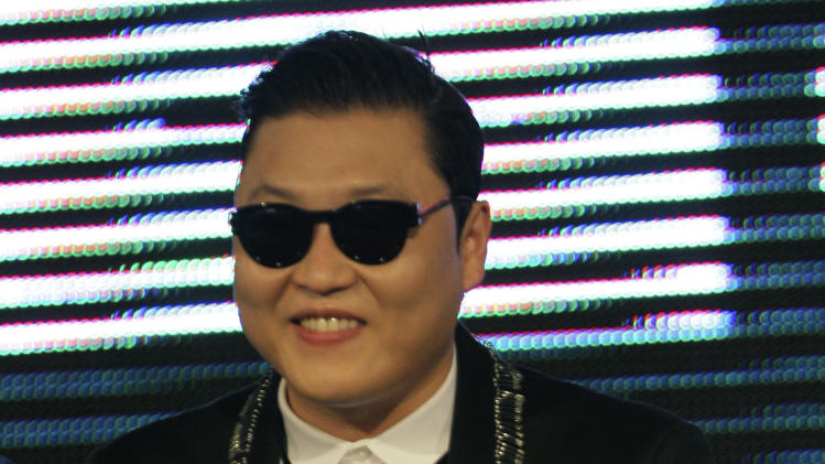 "South Korean rapper PSY, who sings the popular ""Gangnam Style,"" offers a traditional Thai greeting to his fans during a press conference in Bangkok, Thailand, Wednesday, Nov. 28, 2012. PSY will perform in Thailand on Wednesday night -  his first show in Asia outside of South Korea.  (AP Photo/Sakchai Lalit)"