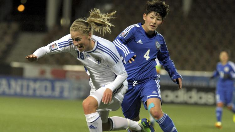 Kazakhstan's Adilya Vyldanova stops Finland's Linda Sallstrom during their women's 2015 World Cup qualifying soccer match in Helsinki
