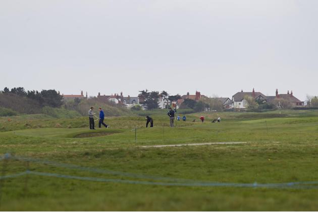 Golfers play at Royal Liverpool Golf Club before the British Open golf championships, Hoylake, England, Wednesday, April 23, 2014. The 2014 Open Championship which will be played at Royal Liverpool fr