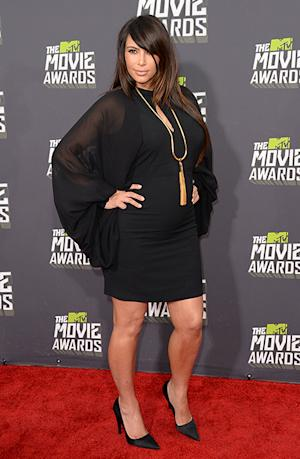 Kim Kardashian Shows Off Baby Bump in Little Black Dress at MTV Movie Awards