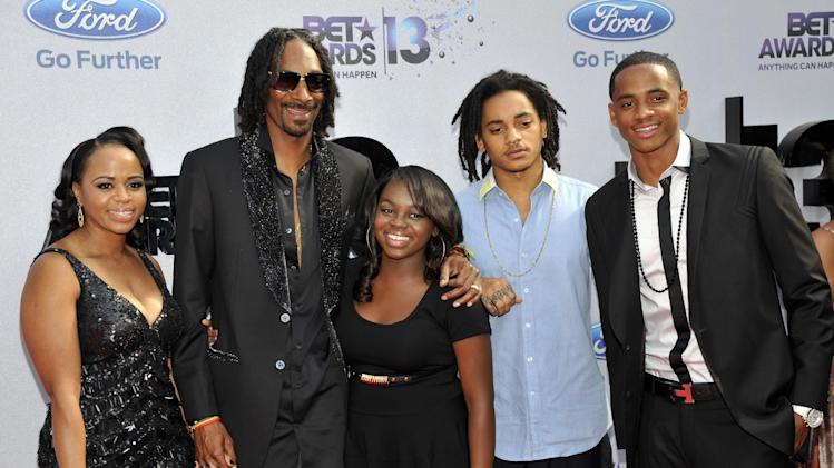 Snoop Dogg and his family arrive at the BET Awards at the Nokia Theatre on Sunday, June 30, 2013, in Los Angeles. (Photo by Chris Pizzello/Invision/AP)