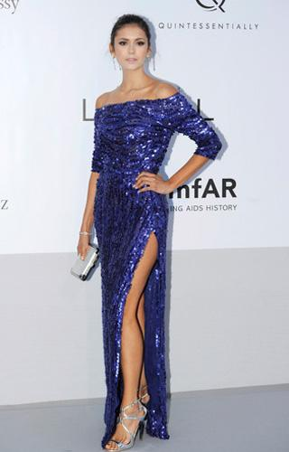 Who: Nina Dobrev What: Elie Saab sequin gown Where: AmfAR Cinema Against AIDS gala Why We Love It:Here Dobrev manages the neat trick of making an elegant evening gown looked shrugged on like a favouri