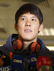 South Korean swimmer Park Tae-Hwan addresses the media as he arrives at Heathrow airport. Sun Yang is geared to lower the world record in his Olympic duel with Asian rival Park in the 400m freestyle at the London Games, his Australian coach Denis Cotterell said Thursday