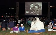 "Moviegoers watch the classic film ""Casablanca"" on an outdoor screen in Washington. The stars of much-loved classic film ""Casablanca"" may always have Paris, but on Wednesday they will have Facebook"