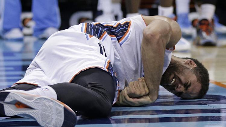 Charlotte Bobcats' Jeff Taylor holds his arm in pain after being injured during the first half of an NBA basketball game against the Miami Heat in Charlotte, N.C., Saturday, Nov. 16, 2013