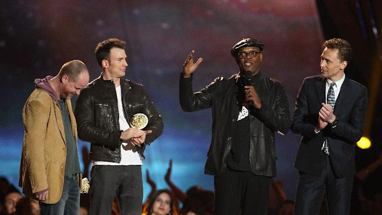 "Joss Whedon, Chris Evans, Samuel L. Jackson and Tom Hiddleston, from left, accept the award for best fight for ""Marvel's The Avengers"" at the MTV Movie Awards in Sony Pictures Studio Lot in Culver City, Calif., on Sunday April 14, 2013. (Photo by Matt Sayles/Invision /AP)"