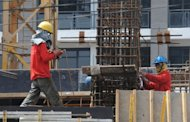 Construction workers are seen at a high-rise building construction site in Manila. As a Philippine property boom gathers pace, even Paris Hilton, Donald Trump and high-fashion house Versace are getting a piece of the action