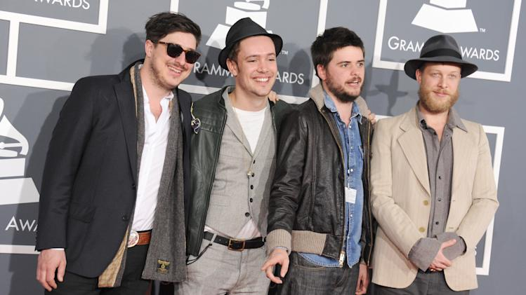 From left, Marcus Mumford, Ben Lovett, Country Winston and Ted Dwane, of musical group Mumford & Sons, arrive at the 55th annual Grammy Awards on Sunday, Feb. 10, 2013, in Los Angeles.  (Photo by Jordan Strauss/Invision/AP)