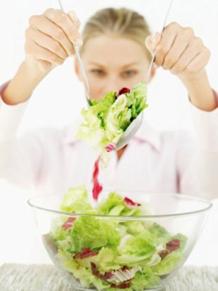 woman serving salad
