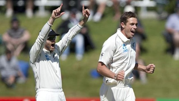 Aaron Redmond (L) and Tim Southee of New Zealand celebrate Kieran Powell of the West Indies being caught out (AFP)