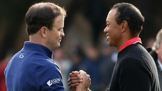 Zach Johnson (L) and Tiger Woods shake hands after Johnson defeated Woods on the first playoff hole during the final round of the Northwestern Mutual World Challenge at Sherwood Country Club on December 8, 2013