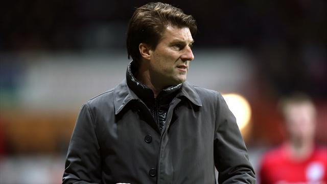 Football - Laudrup relieved to advance