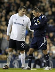 "Tottenham Hotspur's Ryan Nelson (L) consoles Bolton Wanderer's manager Owen Coyle (R) as Bolton's midfielder Fabrice Muamba is treated by medical staff during an English FA Cup match. Muamba was ""critically ill"" in hospital after collapsing suddenly"