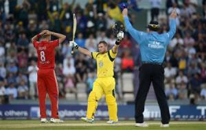 Australia's Finch celebrates after reaching his century from a six during the first T20 international against England at the Rose Bowl cricket ground, Southampton