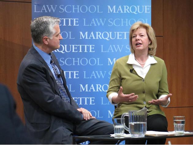 U.S. Sen. Tammy Baldwin, D-Wis., right, takes questions from moderator Mike Gousha at a discussion Wednesday, April 23, 2014, at Marquette University in Milwaukee. Baldwin touted the successes of the