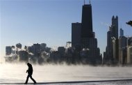 A man is silhouetted against the arctic sea smoke rising off Lake Michigan in Chicago, Illinois January 6, 2014. REUTERS/Jim Young