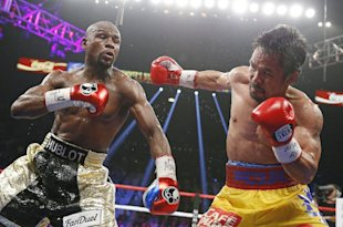 Manny Pacquiao (R) throws a right against Floyd Mayweather Jr. on May 2. (AP)