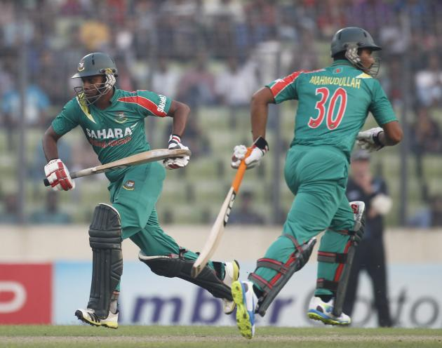 Bangladesh's Sohag Gazi and Mahmudullah run between the wickets during their second one-day international (ODI) cricket match against New Zealand in Dhaka