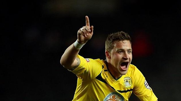 Chris Maguire celebrates scoring one of his two free-kicks on his Sky Blues debut