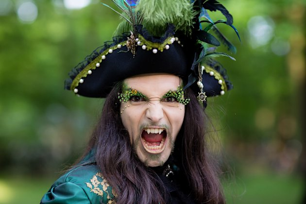 A man with fake vampire teeth wearing a pirate's costume attends the Wave and Goth Festival (Getty Images)