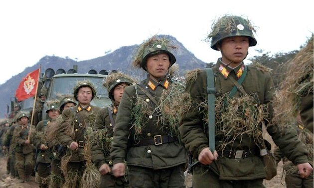 "North Korean People's Army soldiers hold a drill at an undisclosed location on March 11, 2013. North Korea leader Kim Jong-Un threatened to ""wipe out"" a South Korean island as Pyongyang comes under new economic and diplomatic fire from US sanctions and UN charges of gross rights abuses"
