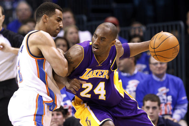 Los Angeles Lakers guard Kobe Bryant (24) drives around Oklahoma City Thunder guard Thabo Sefolosha, left, in the first quarter of Game 5 in their NBA basketball Western Conference semifinal playoff s
