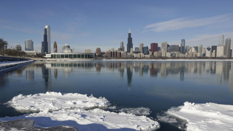 Ice floats on the surface of Lake Michigan Friday, Jan. 3, 2014, in Chicago. Single-digit temperatures are hitting Illinois after the state was blanketed in snow. Meanwhile, residents are bracing for a deep freeze. Highs early next week likely won't reach zero and wind chills could sink to 45 below. (AP Photo/M. Spencer Green)
