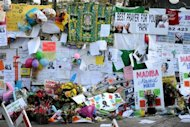 "Well wishing messages and flowers left for former South African President Nelson Mandela in Pretoria on July 5, 2013. Mandela's doctors advised his family to turn off the ailing icon's life-support machines last week, a court document has shown, prompting South Africa's government to say he was not ""in a vegetative state"""