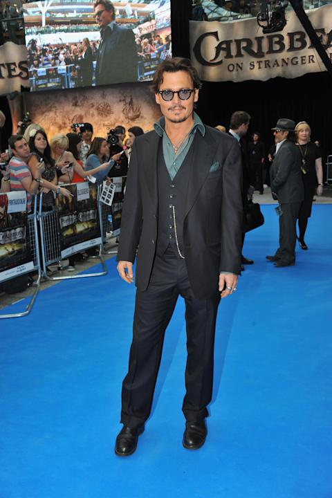Depp in a three-piece suit