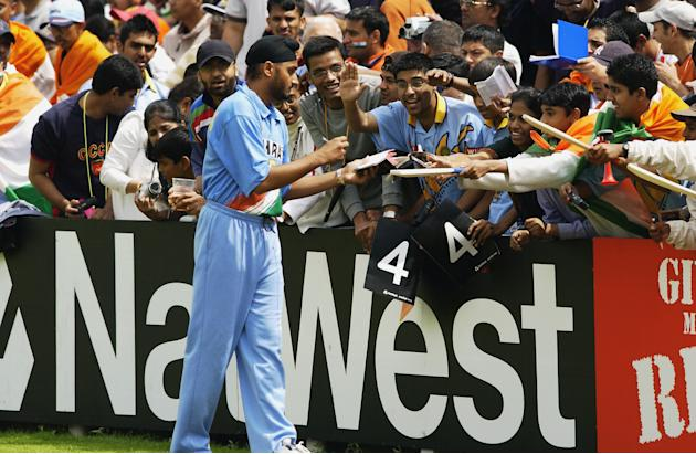 Harbhajan Singh of India signs autographs