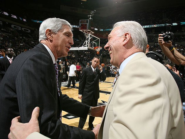 Jerry Sloan tells Gregg Popovich about the 'pencil inside the spool' trick. (Getty Images)