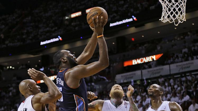 Charlotte Bobcats' Al Jefferson (25) shoots in front of Miami Heat's Ray Allen (34), Chris Andersen (11) and Chris Bosh (1) during the second half in Game 1 of an opening-round NBA basketball playoff series, Sunday, April 20, 2014, in Miami. The Heat defeated the Bobcats 99-88