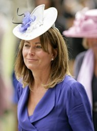 Carole Middleton borrows one of Kate's hats. Photo by Getty Images.