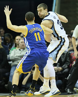 Dec 16, 2014; Memphis, TN, USA; Memphis Grizzlies center Marc Gasol (33) is defended by Golden State Warriors guard Klay Thompson (11) at FedExForum. Grizzlies defeated the Warriors 105-98. (Nelson Chenault-USA TODAY Sports)