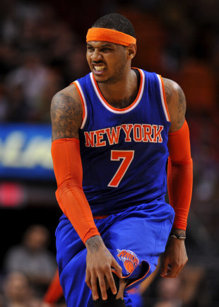 Melo reacts to an apparent injury on Monday. (Steve Mitchell-USA TODAY Sports)
