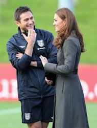 Britain's Catherine, Duchess of Cambridge speaks with England and Chelsea footballer Frank Lampard during the official launch of the Football Association's National Football Centre. Prince William and his wife Catherine opened English football's new centre of excellence on Tuesday -- and were introduced to defender Ashley Cole despite his Twitter furore