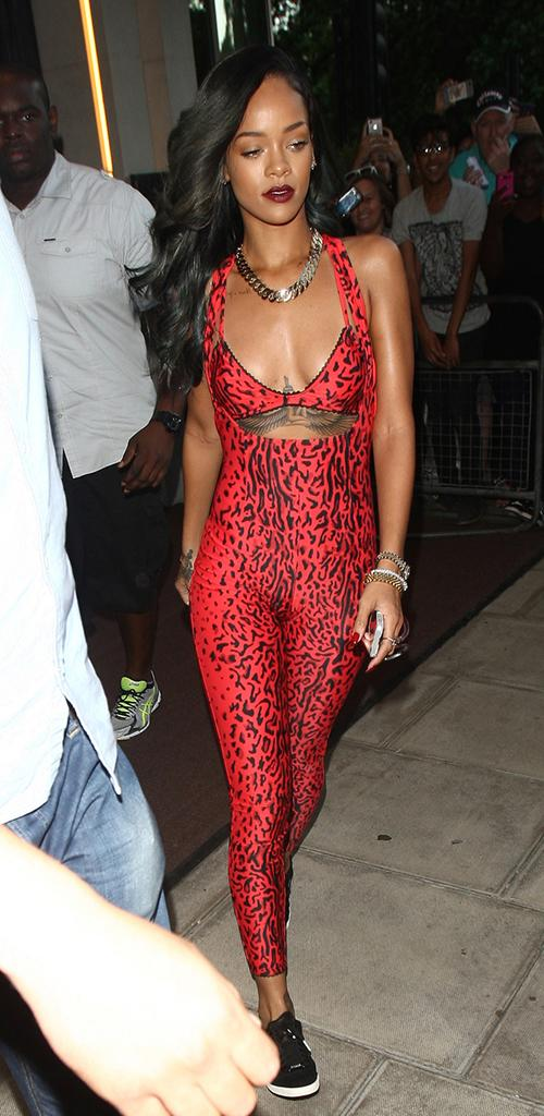 Rihanna leaves little to the imagination with a red cheetah print one piece as she heads out of her hotel in London