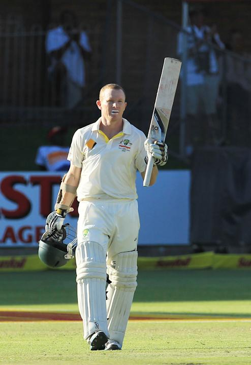 Australia's batsman Chris Rogers, raises his bat after reaching his century on the fourth day of their 2nd cricket test match against South Africa at St George's Park in Port Elizabeth, South