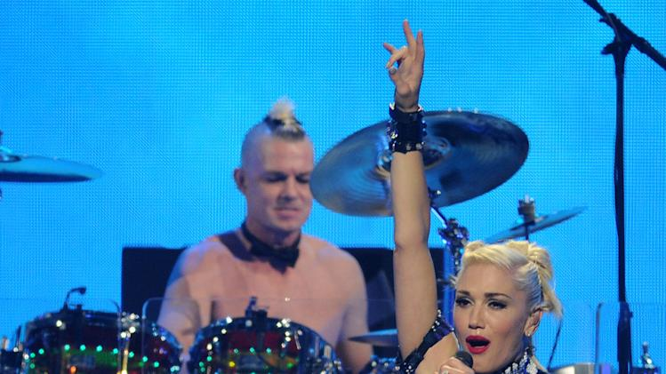 Gwen Stefani and drummer Adrian Young of No Doubt perform at the iHeart Radio Music Festival on Friday, Sept., 21, 2012 at the MGM Grand Arena in Las Vegas. (Photo by Eric Reed/Invision/AP)