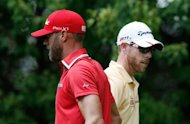 (L-R) Graham Delaet and David Hearn of Canada wait on the fifth tee during the first round of the BMW Championship at Crooked Stick Golf Club on September 6, 2012 in Carmel, Indiana