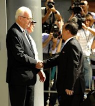 "US Ambassador Stephen Bosworth, the Obama administration's top envoy on North Korean affairs, greets North Korean Vice Foreign Minister Kim Kye-Gwan (R) at the US Mission to the United Nations in New York. The United States on Thursday pressed North Korea to take ""concrete and irreversible"" steps to give up its nuclear arsenal at talks on how to improve hostile relations"