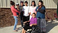 Jasmine Benoit, who was not in the crash, holds her two-year-old son Kageon Carver who was in the crash. Next to her (left to right) are Ginew Kent, 18, Josh Prince, 16, Mary Ryder, 13, Marissa Carver, 11 (in wheelchair), Taylor Kent, 14.