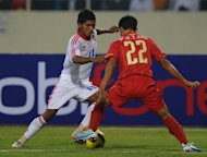 File picture. Vietnam's Phan Van Tai Em, right, tackles Myanmar's Kyaw Ko Ko at the AFF Suzuki Cup group B match in Hanoi in 2010. Myanmar stood among the best in Asia from the mid-1960s to the 1970s, which is regarded as the country's golden age for football, but has had a four-decade slide to a record low in the world rankings