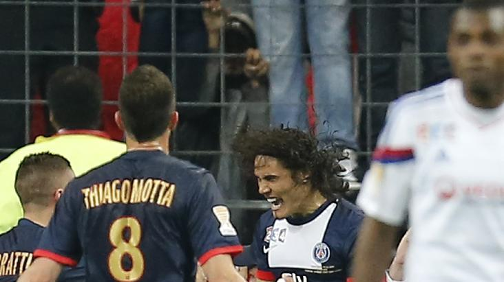 Paris Saint Germain's Edinson Cavani of Argentina, center, celebrates scoring against Olympic Lyonnais during the French League Cup Final soccer match at the Stade de France in Saint Denis, north of Paris, Saturday April 19, 2014