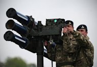 A Starstreak high velocity missile system, which may play a role in providing air security for the Olympics, is manned by members of the British Royal Artillery during a media demonstration at Blackheath in London in May 2012. British authorities insisted that Olympic security would not be compromised after having to draft in an extra 3,500 troops