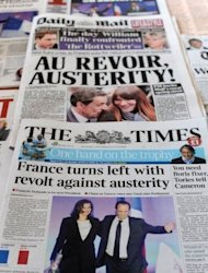 The front pages of British newspapers report the victory of Francois Hollande in the French presidential election. The yield on French bonds initially rose but then dipped to below Friday's closing rate