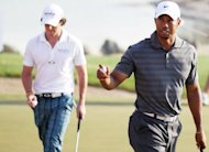 Rory Mcilroy (left) and Tiger Woods pictured during the Abu Dhabi Championship in January 2012. World number one McIlroy will take on 14-time Major winner Woods in the one-day Duel at Jinsha Lake matchplay contest in China in October, organisers say