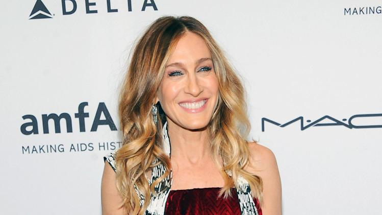FILE - This Feb. 6, 2013 file photo shows actress Sarah Jessica Parker at amfAR's New York gala at Cipriani Wall Street in New York. Parker is donating a pair of Dolce Vita Pumps for a celebrity shoe auction benefitting LaGuardia High School of Music, Art and the Performing Arts. The special edition auction will take place starting Wednesday April 24, on https://ec.yimg.com/ec?url=http%3a%2f%2fwww.gottahaverockandroll.com.&t=1398329673&sig=wuDVxdqlUBCqsPQkXtZurA--~B (Photo by Evan Agostini/Invision/AP, file)